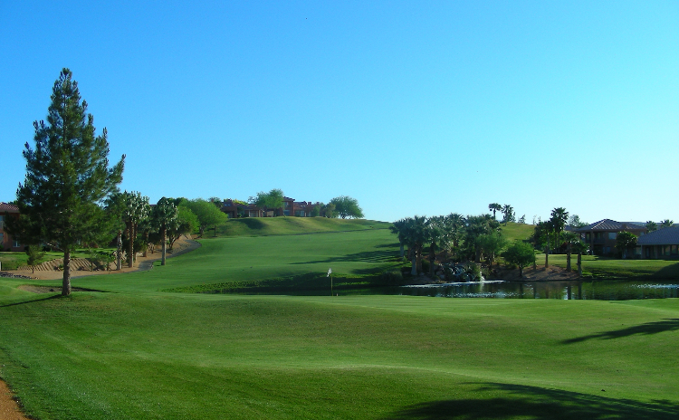 A winding fairway at Oasis Golf Club